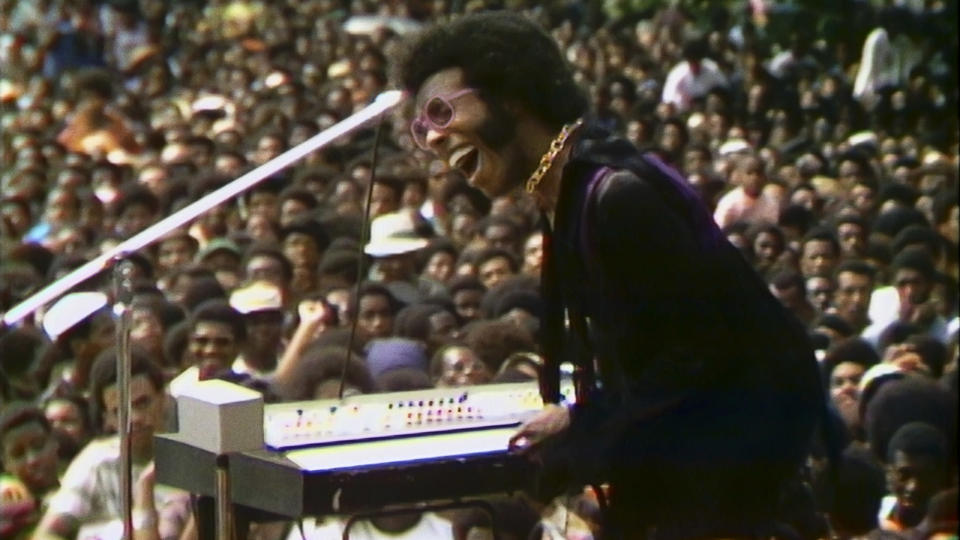 """This image released by Searchlight Pictures shows Sly Stone performing at the Harlem Cultural Festival in 1969, featured in the documentary """"Summer of Soul."""" (Searchlight Pictures via AP)"""