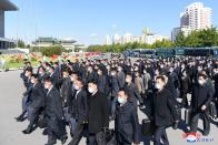 Delegates arrive for the celebrations for the 75th founding anniversary of the WPK at Pyongyang