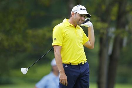 Sergio Garcia of Spain watches his tee shot on the fourth hole during the final round of the Deutsche Bank Championship golf tournament in Norton