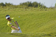 Y.E. Yang chips to the green on the sixth hole during the second round of the PGA Championship golf tournament on the Ocean Course Friday, May 21, 2021, in Kiawah Island, S.C. (AP Photo/Chris Carlson)