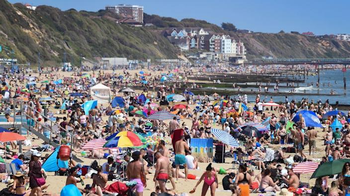 Crowds flocked to the beach at Bournemouth, to enjoy the soaring temperatures on bank holiday Monday last month