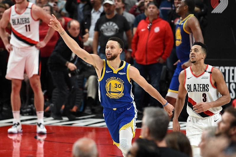 Golden State star Stephen Curry celebrates after a 119-117 overtime victory over the Portland Trail Blazers that put the Warriors into the NBA Finals for a fifth straight year (AFP Photo/Steve DYKES)