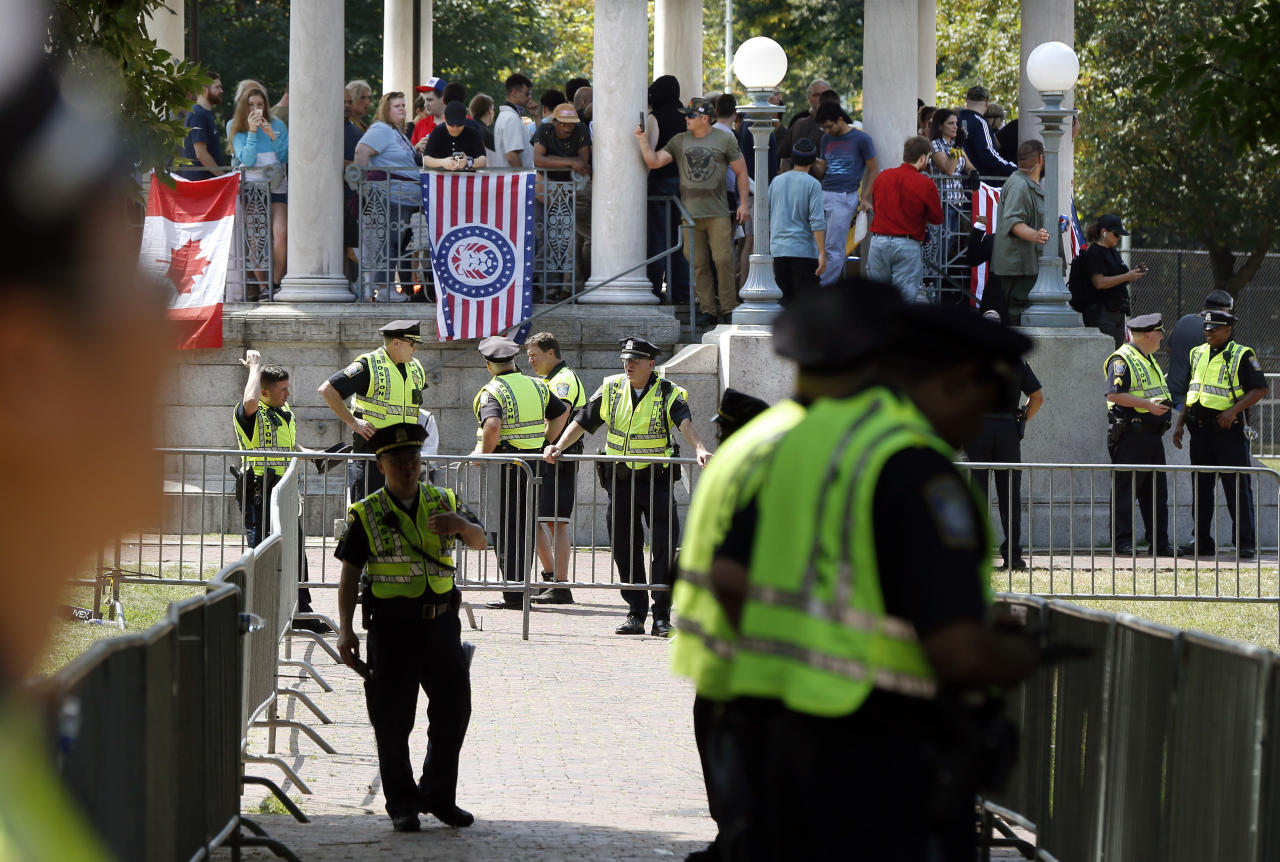 "<p>Police prepare to escort organizers from the bandstand on Boston Common after a ""Free Speech"" rally staged by conservative activists, Saturday, Aug. 19, 2017, in Boston. One of the planned speakers of a conservative activist rally that appeared to end shortly after it began says the event ""fell apart."" Dozens of rallygoers gathered Saturday on Boston Common, but then left less than an hour after the event was getting underway. (Photo: Michael Dwyer/AP) </p>"