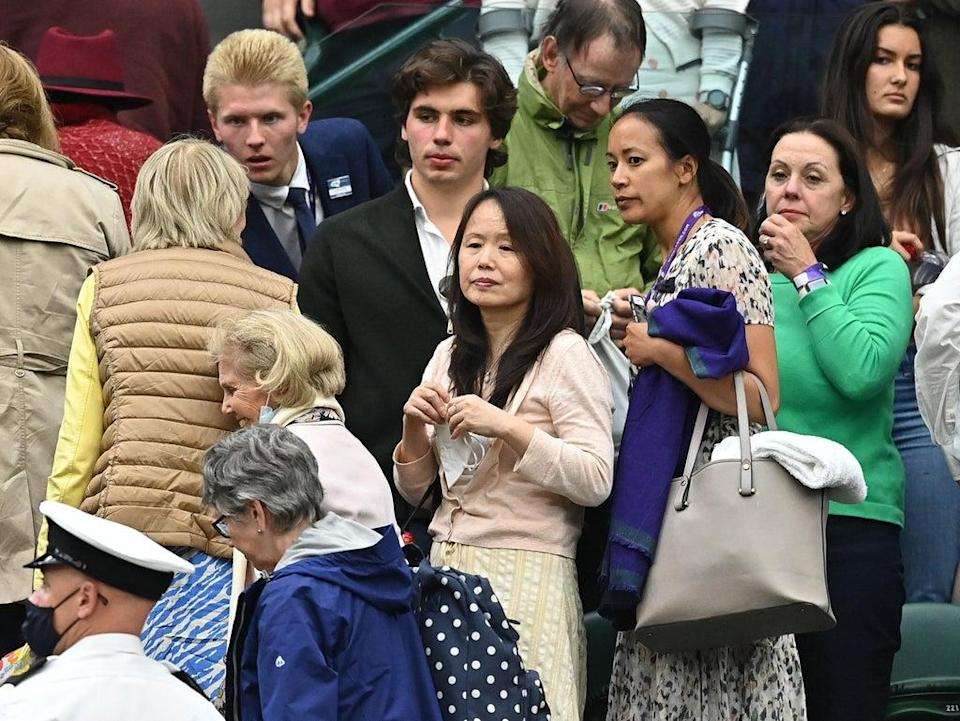 Renee Raducanu (centre) among the crowd for her daughter's match at Wimbledon on 5 July 2021 (Ben Stansall/AFP/Getty)