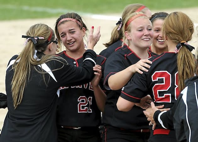 Jayme Langbehn, second from left, celebrates Elk River's state title — St. Paul Pioneer Press
