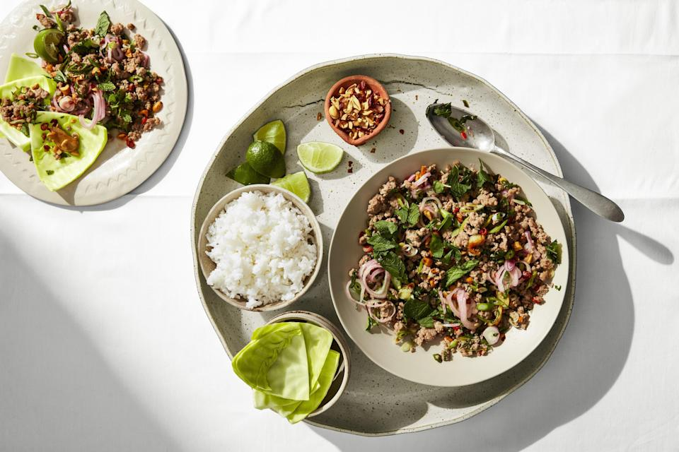 """Larb will not only fill your belly, it will teach you how to balance sweet, sour, salty, spicy, funky, and umami flavors. Larb hails from Laos and gets its addictiveness from the way it stitches together ground meat and crunchy, juicy textures. When you get the balance right, this dish sings, each bite creating a craving for more. <a href=""""https://www.epicurious.com/recipes/food/views/spicy-larb-with-cabbage-cups?mbid=synd_yahoo_rss"""" rel=""""nofollow noopener"""" target=""""_blank"""" data-ylk=""""slk:See recipe."""" class=""""link rapid-noclick-resp"""">See recipe.</a>"""