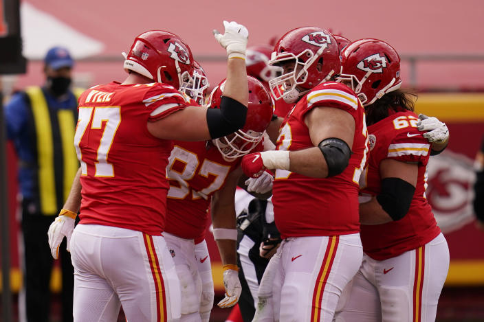 Kansas City Chiefs tight end Travis Kelce (87) is congratulated after catching a four-yard touchdown pass during the first half of an NFL football game, Sunday, Dec. 27, 2020, in Kansas City. (AP Photo/Jeff Roberson)