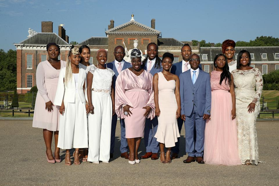 LONDON, ENGLAND - JULY 24:  The Kingdom Choir perform outside Kensington Palace on July 24, 2018 in London, England. The choir, which performed at the Royal Wedding of Prince Harry to Ms. Meghan Markle, announced that they have signed a record deal with Sony Music.  (Photo by Mike Marsland/Mike Marsland/WireImage)