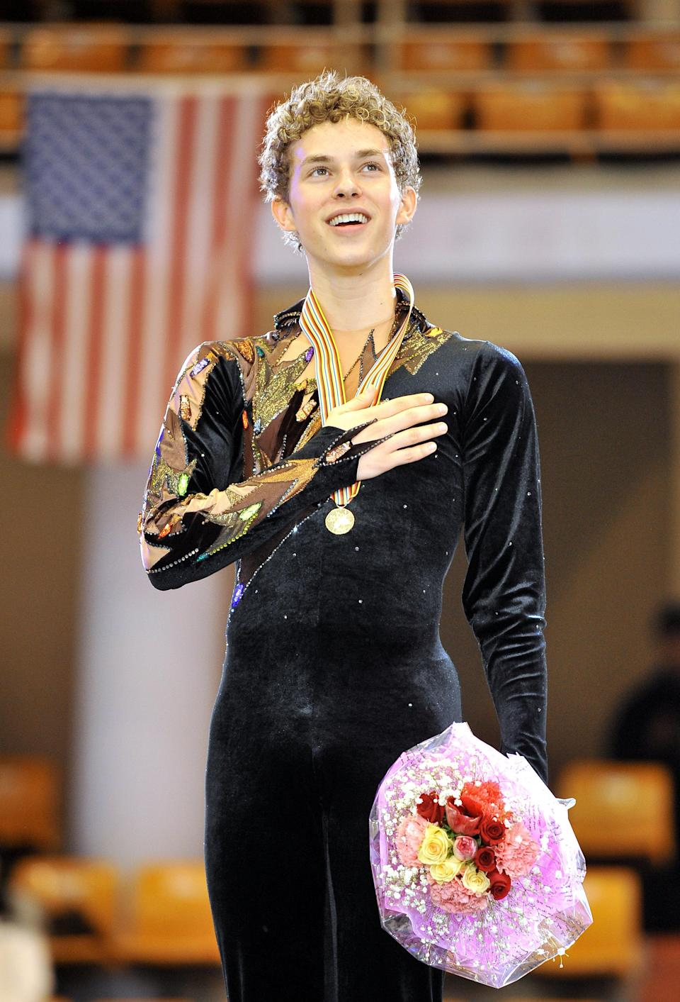<p>Adam Rippon of the US sings his national anthem during the victory ceremony after the men's free skating event during the ISU Four Continents Figure Skating Championships.<br>(Photo by Jung Yeon-JE/AFP/Getty Images) </p>