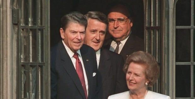 Economic summit leaders (from left) Ronald Reagan, Brian Mulroney and Helmut Kohl follow Margaret Thatcher into a courtyard at Hart House in Toronto, June 20, 1988.