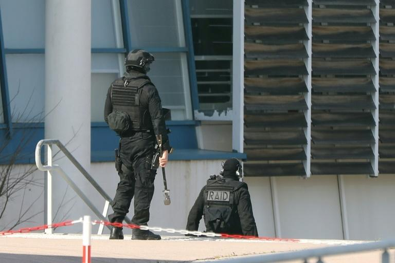 Members of the RAID French police unit on the scene of a shooting at Tocqueville high school in the southern town of Grasse on March 16, 2017