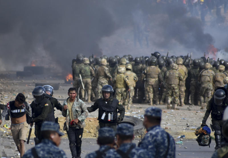 Police detain supporters of former President Evo Morales during clashes in Sacaba, Bolivia, Friday, Nov. 15, 2019. A least five people died and dozens were injured during the clashes. (AP Photo/Dico Solis)