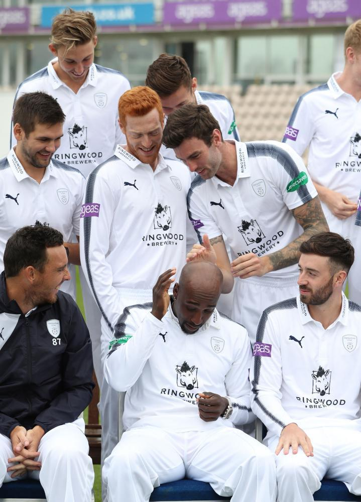 Hampshire's Reece Topley brushes the back of Michael Carberry's head during the media day at the Ageas Bowl