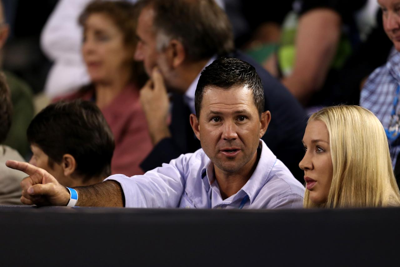 MELBOURNE, AUSTRALIA - JANUARY 23:  Former Australian cricketer Ricky Ponting and his wife Rihanna Ponting attend the Men's Quarterfinal match between Roger Federer of Switzerland and Jo-Wilfred Tsonga of France during day ten of the 2013 Australian Open at Melbourne Park on January 23, 2013 in Melbourne, Australia.  (Photo by Scott Barbour/Getty Images)