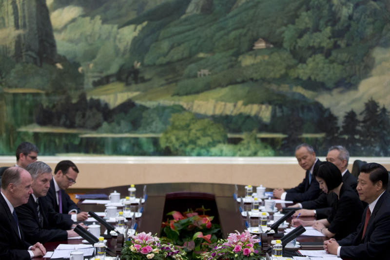 U.S. National Security Adviser Tom Donilon, left, and Chinese President Xi Jinping, right, attend their meeting at the Great Hall of the People in Beijing, China, Monday, May 27, 2013. (AP Photo/Alexander F. Yuan, Pool)