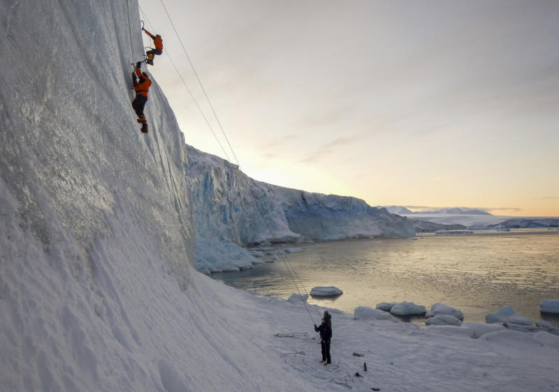 Two men are seen climbing in Antarctica.