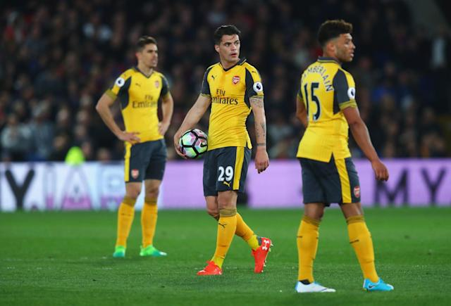 <p>Granit Xhaka looks on unhappily after Palace's third goal</p>