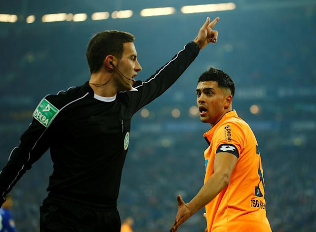 Soccer Football - Bundesliga - Schalke 04 vs TSG 1899 Hoffenheim - Veltins-Arena, Gelsenkirchen, Germany - February 17, 2018 Hoffenheim's Nadiem Amiri appeals to referee Benjamin Brand REUTERS/Leon Kuegeler DFL RULES TO LIMIT THE ONLINE USAGE DURING MATCH TIME TO 15 PICTURES PER GAME. IMAGE SEQUENCES TO SIMULATE VIDEO IS NOT ALLOWED AT ANY TIME. FOR FURTHER QUERIES PLEASE CONTACT DFL DIRECTLY AT + 49 69 650050