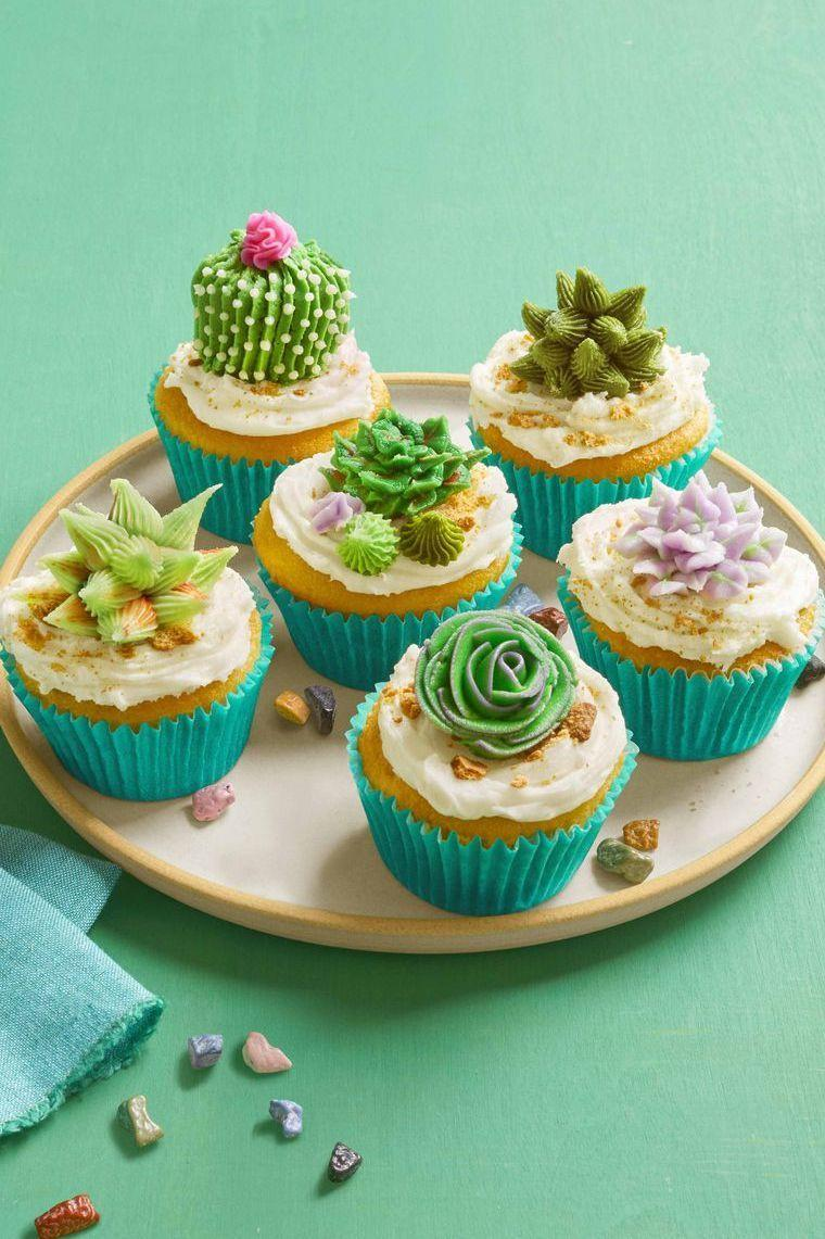 """<p>Not quite as springy as daffodil or tulip treats — but equally as adorable and delicious. </p><p><a class=""""link rapid-noclick-resp"""" href=""""https://www.amazon.com/dp/B01N18U0YL/ref=twister_B07G7YLCT3?tag=syn-yahoo-20&ascsubtag=%5Bartid%7C10055.g.883%5Bsrc%7Cyahoo-us"""" rel=""""nofollow noopener"""" target=""""_blank"""" data-ylk=""""slk:SHOP PIPING BAGS"""">SHOP PIPING BAGS</a> </p><p><em><a href=""""https://www.womansday.com/food-recipes/food-drinks/a26356939/desert-bloom-cupcakes-recipe/"""" rel=""""nofollow noopener"""" target=""""_blank"""" data-ylk=""""slk:Get the recipe from Woman's Day »"""" class=""""link rapid-noclick-resp"""">Get the recipe from Woman's Day »</a></em></p>"""