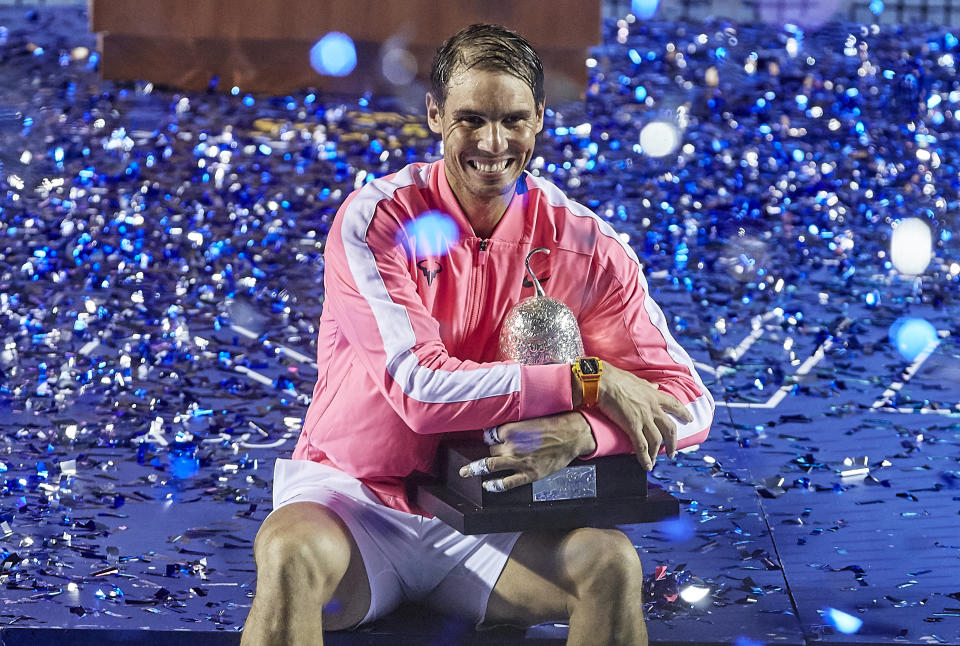 ACAPULCO, MEXICO - FEBRUARY 29: Rafael Nadal of Spain celebrates with the trophy after winning Mexican Open against Taylor Fritz of United States during day six of the ATP Mexican Open 2020 at Princess Mundo Imperial on February 29, 2020 in Acapulco, Mexico. (Photo by Quality Sport Images/Getty Images)