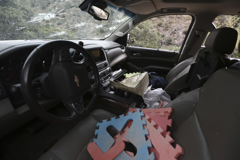 Foam floor puzzle pieces seen inside a bullet-riddled a vehicle that members of LeBaron family were traveling in, sits parked on a dirt road near Bavispe, at the Sonora-Chihuahua border, Mexico, Wednesday, Nov 6, 2019. Three women and six of their children, related to the extended LeBaron family, were gunned down in an attack while traveling along Mexico's Chihuahua and Sonora state border on Monday. (AP Photo/Christian Chavez)