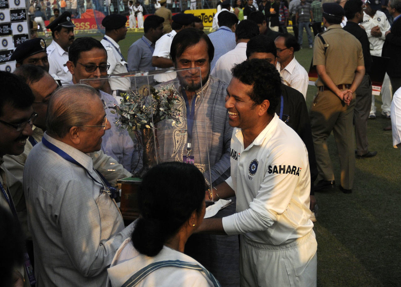 Sachin Tendulkar of India receives momento from Jagmohan Dalmiya president of CAB during day three of the first Star Sports test match between India and The West Indies held at The Eden Gardens Stadium in Kolkata, India on the 8th November 2013  Photo by: Pal Pillai - BCCI - SPORTZPICS