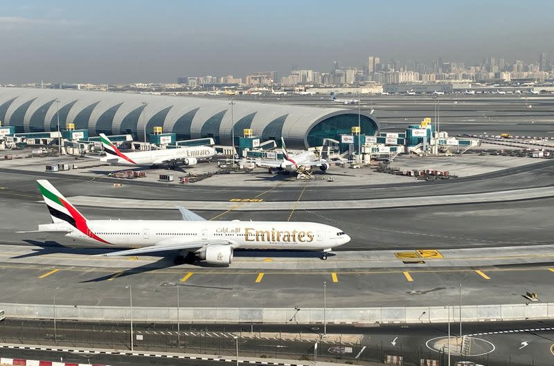 FILE PHOTO: Emirates airliners are seen on the tarmac in a general view of Dubai International Airport