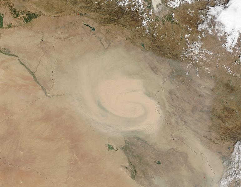 A natural-color image of the dust storm from NASA (AFP Photo/)