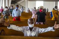 Worshipers attend Mass at the Cathedral of Port-au-Prince, marking the reopening of places of worship since the beginning in March of the COVID-19 lockdown, in Port-au-Prince, Haiti, Sunday, July 12, 2020. By order of President Jovenel Moise and the recommendation of Haiti's health authorities, churches reopened after having been closed for months due to social distancing rules to curb the spread of the pandemic. (AP Photo/Dieu Nalio Chery)