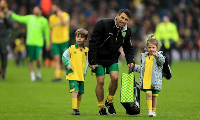 Wes Hoolahan of Norwich City walks on the pitch with his children after grabbing a goal and an assist on his final appearance for the club at Carrow Road, against Leeds United.