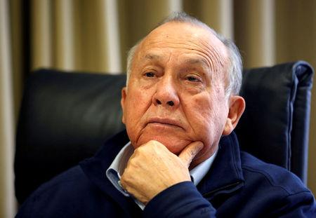 FILE PHOTO: South African magnate Christo Wiese, Steinhoff's largest shareholder and chairman, listens during an interview in Cape Town
