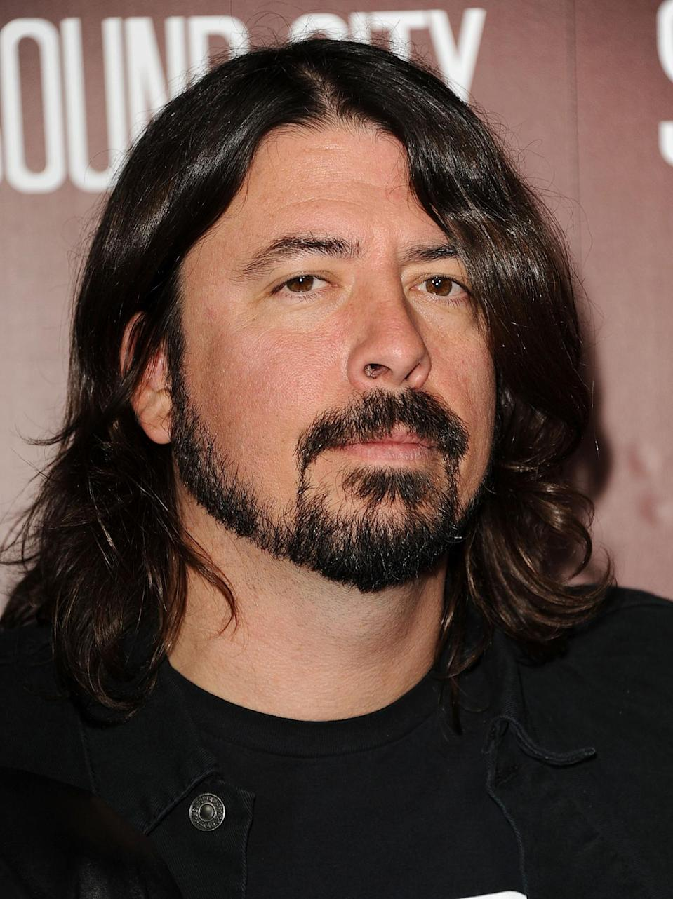 <p>After drumming for Nirvana and becoming the frontman for the Foo Fighters, Dave Grohl grew his hair even longer — with a formidable goatee. <i>(Photo: Getty Images)</i></p>