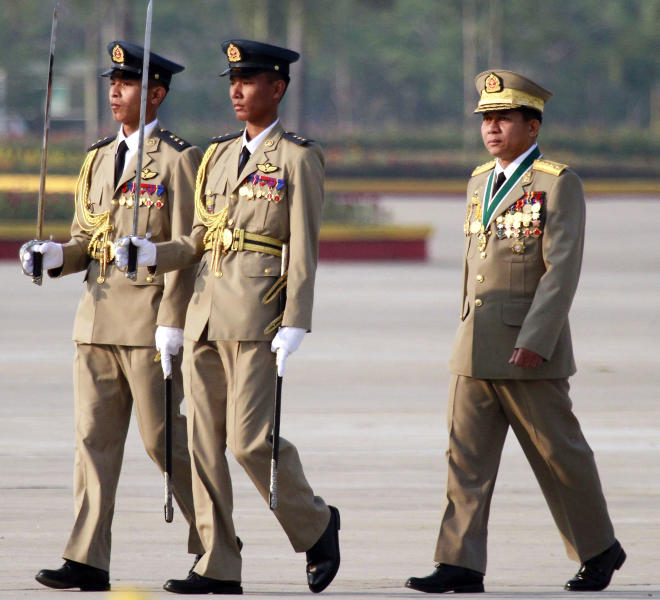 Myanmar Army Gen. Min Aung Hlaing, right, inspects Myanmar soldiers in a ceremony to mark Myanmar's 67th Armed Forces Day in Naypyitaw, Myanmar, Tuesday, March 27, 2012. The Myanmar military leader defended the military's active role in government and said he will protect the nation's pro-military constitution in his speech at the ceremony. (AP Photo/Khin Maung Win)