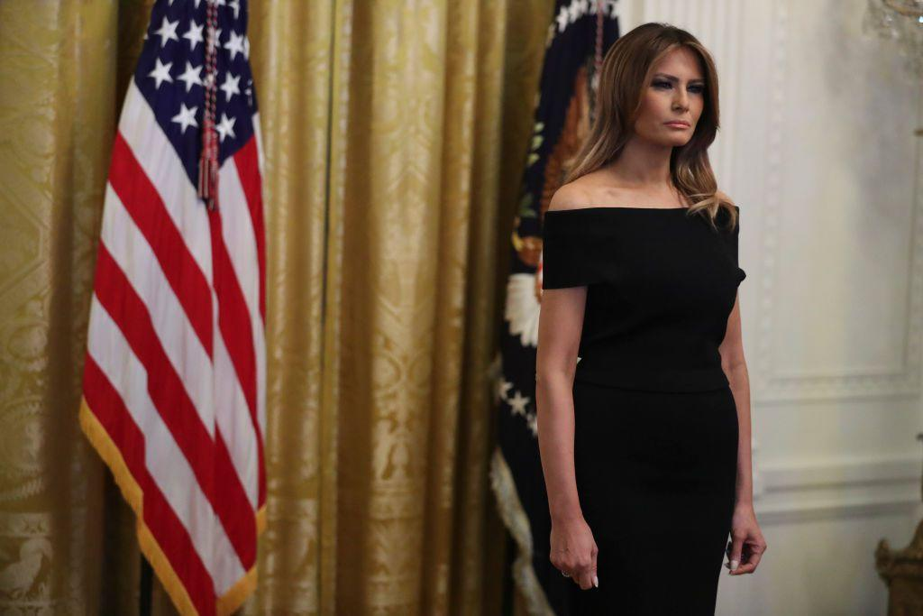 <p>Melania kept it simple for the White House Hanukkah reception wearing an off-the shoulder black cocktail dress by Scanlan Theodore. <br></p>