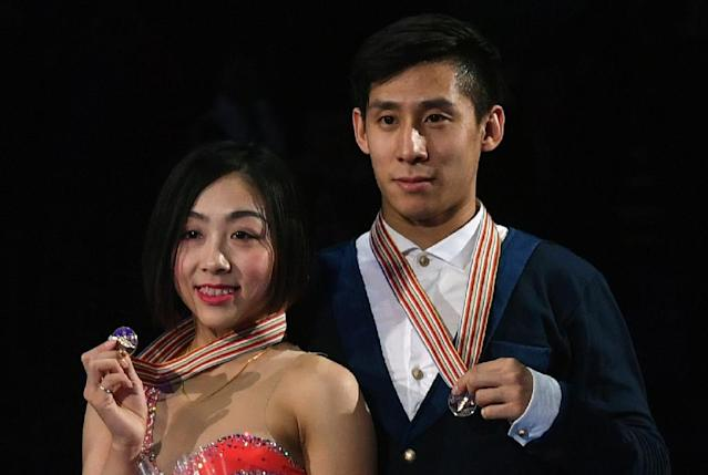 Gold medallists China's Sui Wenjing and Han Cong pose with their medals on the podium after the pairs free skating event at the ISU World Figure Skating Championships in Helsinki, Finland on March 30, 2017 (AFP Photo/Daniel MIHAILESCU)