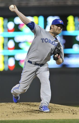 Toronto Blue Jays starting pitcher Kyle Drabek throws against the Minnesota Twins in the first inning of a baseball game on Friday, May 11, 2012, in Minneapolis. (AP Photo/Jim Mone)