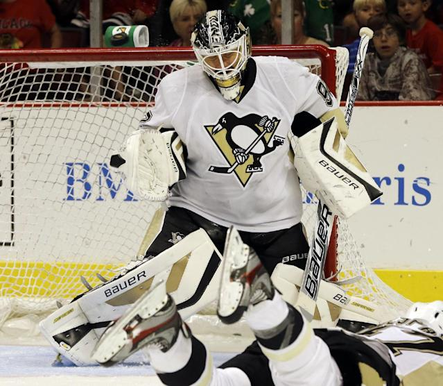 Pittsburgh Penguins goalie Tomas Vokoun blocks a shot by Chicago Blackhawks' Patrick Kane during the second period of an NHL preseason hockey game in Chicago, Thursday, Sept. 19, 2013. (AP Photo/Nam Y. Huh)
