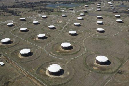 FILE PHOTO: Crude oil storage tanks are seen from above at the Cushing oil hub, in Cushing, Oklahoma, U.S., March 24, 2016. REUTERS/Nick Oxford/File Photo