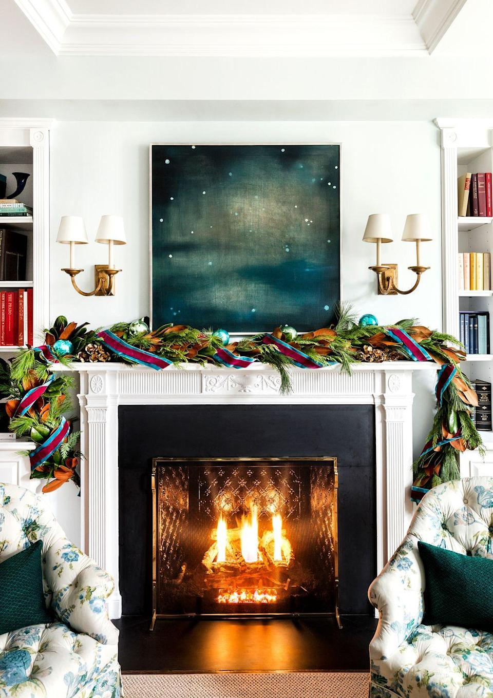 <p>Decorate your mantle with greenery, then add ribbons and ornaments for a pop of color. Match your garland accessories to wall art and decor throughout the space rather than using the classic Christmas colors for an understated yet festive look. </p>