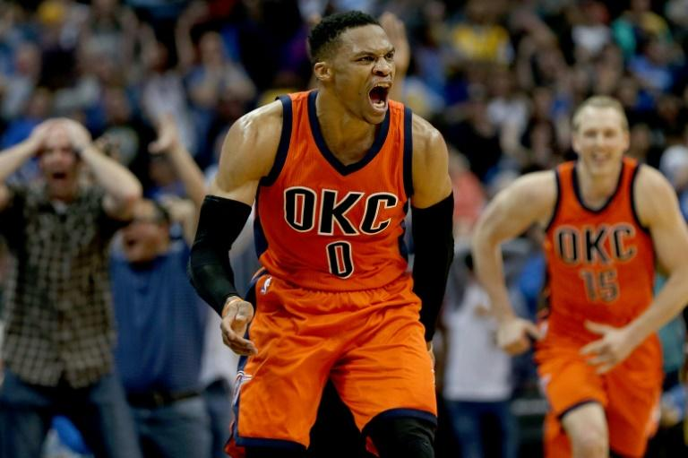 Russell Westbrook of the Oklahoma City Thunder celebrates after scoring a game-winning three-pointer at the buzzer against the Denver Nuggets, at Pepsi Center in Denver, Colorado, on April 9, 2017
