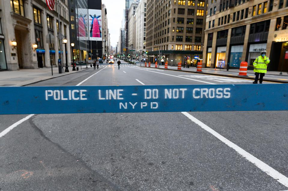 """NEW YORK, NY - MARCH 31: A view of an NYPD 'do not cross' barricade during NYC's """"Open Streets"""", which closes some streets to vehicle traffic to allow more space for pedestrians, as restrictions are in place to stop the spread of coronavirus on March 29, 2020 in New York City. President Trump has extended the social distancing guidelines to April 30. (Photo by Noam Galai/Getty Images)"""