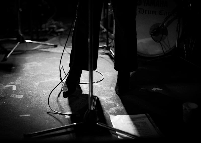 New female singer Eliott's shoes is pictured here on stage with her set list and band