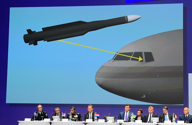 TOPSHOT - Members of a joint investigation team present the preliminary results of the criminal investigation into the downing of Malaysia Airlines flight MH17, in Nieuwegein, on September 28, 2016. Last year a separate inquiry led by the Dutch Safety Board (OVV) found the Boeing 777 was hit by a BUK missile fired from an area most likely in rebel-held eastern Ukraine, where pro-Russian separatists have been battling Ukrainian forces since early 2014. / AFP PHOTO / EMMANUEL DUNAND (Photo credit should read EMMANUEL DUNAND/AFP/Getty Images)