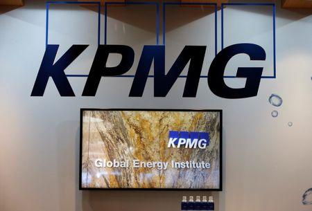 FILE PHOTO - Logos of KPMG are seen in its booth at Gastech, the world's biggest expo for the gas industry, in Chiba, Japan April 4, 2017. REUTERS/Toru Hanai