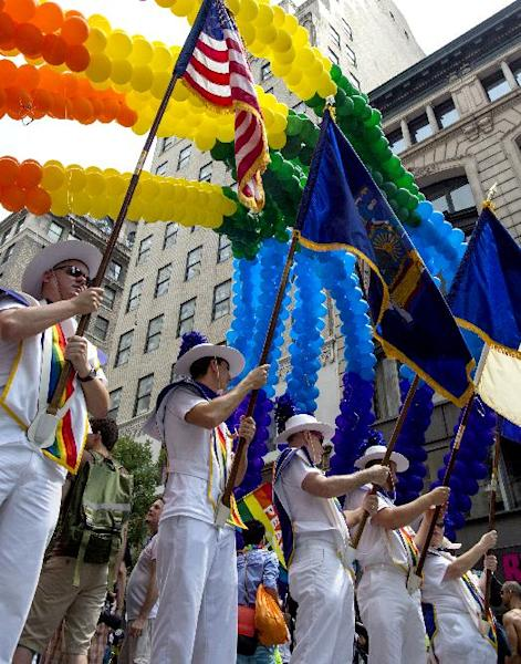 A color guard lines up at the start of the gay pride march in New York Sunday, June 30, 2013. (AP Photo/Craig Ruttle)