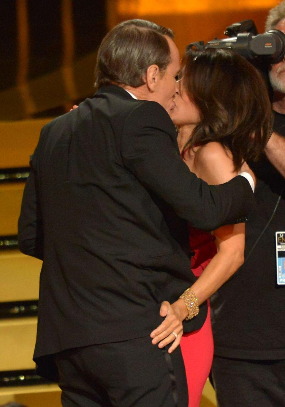 <p>Remember when Bryan Cranston appeared on <em>Seinfeld</em> as Julia Louis-Dreyfus' character's love interest? At the 2014 Emmys, they reminded everyone of that. As Louis-Dreyfus made her way to the stage to accept her award for Outstanding Lead Actress in a Comedy Series, Cranston grabbed her for a quick makeout session. <br></p>