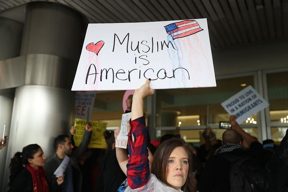 Tristan Houghton joins with other protesters as they stand together at the Miami International Airport against the executive order that President Donald Trump signed clamping down on refugee admissions and temporarily restricting travelers from seven predominantly Muslim countries on January 29, 2017 in Miami, Florida.
