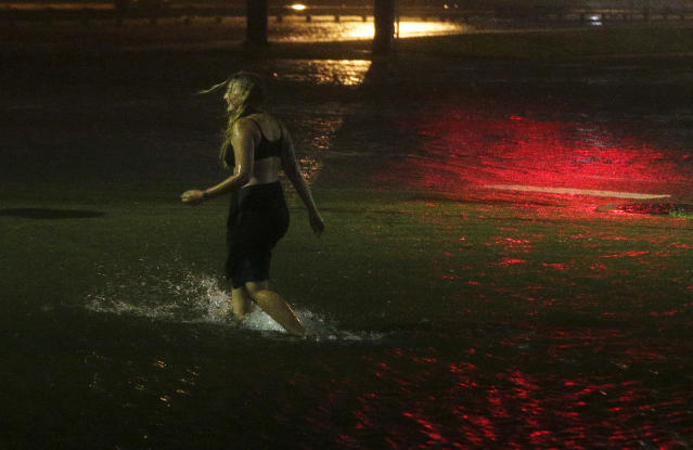 <p>A woman wades through a flooded Water St. in downtown Mobile, Ala., during Hurricane Nate, Sunday, Oct. 8, 2017, in Mobile, Ala. Hurricane Nate came ashore along Mississippi's coast outside Biloxi early Sunday, the first hurricane to make landfall in the state since Hurricane Katrina in 2005. (Photo: Brynn Anderson/AP) </p>
