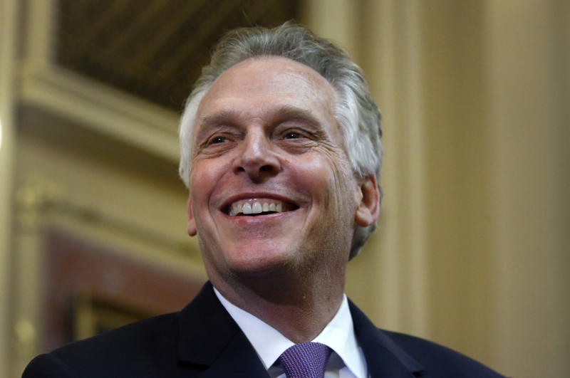 "Virginia Gov. Terry McAuliffe delivers his final ""State of the Commonwealth"" address to the General Assembly at the Capitol in Richmond, Va., Wednesday, Jan. 10, 2018. McAuliffe stopped to acknowledge the crowd before his speech. (Bob Brown/Richmond Times-Dispatch via AP)"