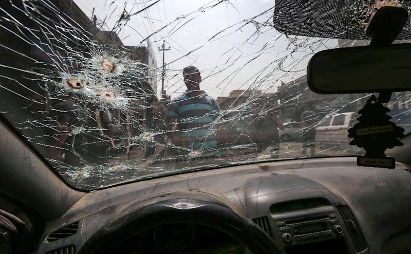 A bullet-riddled car is seen at a garage in the Iraqi city of Mosul on September 6, 2017